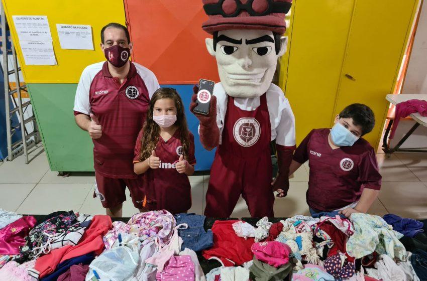 Maquinista grená faz doações de roupas para ONG em Cariacica